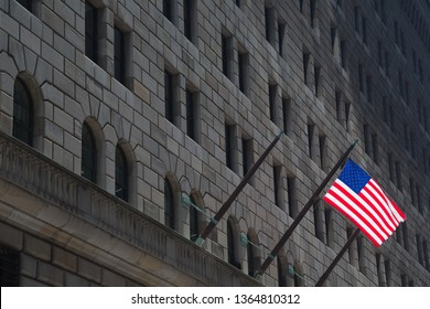New York City, USA - August 4, 2013: Federal Reserve building & American Flag, New York. Buikding in shadow with only the american flg in full light.