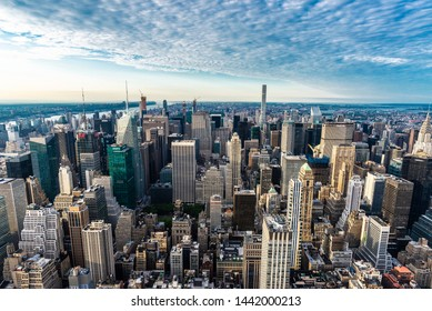 New York City, USA - August 1, 2018: Elevated view of the skyline of modern skyscrapers of Manhattan at sunset in New York City, USA