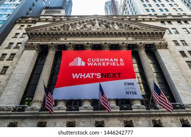 """New York City, USA - August 1, 2018: Headquarters of New York Stock Exchange (NYSE, nicknamed """"The Big Board"""") with an ad for Cushman & Wakefield in Wall Street, Lower Manhattan, New York City, USA."""