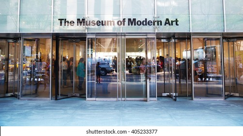 New York City, USA - August 10, 2015: the entrance of Museum of Modern Art from outside. Some people are visible in the internal hall.