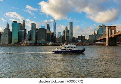 New York City, USA - August 16, 2017: American police boat N.Y.P.D patrolling under the Brooklyn Bridge in Manhattan New York City, USA.