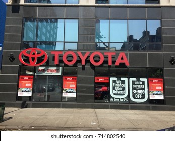 NEW YORK CITY, USA - AUGUST 2017: Uber and Toyota have strategic investment and auto leasing deal. Deal helps Uber expand financing program and will also bolster moves into self-driving vehicle future