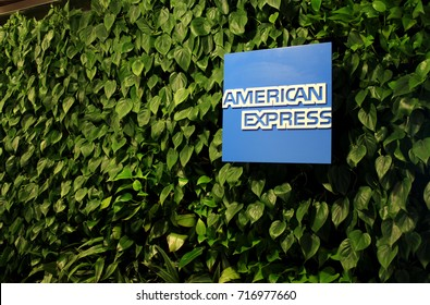 NEW YORK CITY, USA – AUGUST 14 2015: American Express logo on display in the AMEX Centurion Lounge at New York LaGuardia Airport. A green living wall greets guests at the entrance.