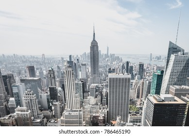 New York City, New York/ USA - August-21-2017: View from rockefeller center plattform over big apple new york city at a light cloudy day with blue sky