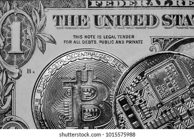 New York City, New York, USA - Circa January 2018: Monochrome image of Bitcoin crypto currency seen laying on a regular One Dollar banknote. Detail of the coinage and patterns are clearly visible.