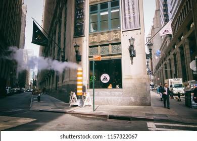 NEW YORK CITY, USA - CIRCA MAY 2018: Corner of Beaver Street and Wall Street on a sunny day