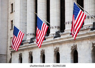 NEW YORK CITY, USA - CIRCA SEPTEMBER 2014: Flags of the USA outside the New York Stock Exchange