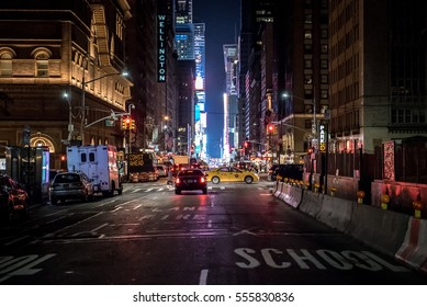 NEW YORK CITY, USA - CIRCA JUNE 2017: A view of the bright lights of Times Square in the distance. Times Square is a famous landmark in midtown Manhattan with bright billboards and advertisements.