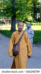 NEW YORK CITY, NEW YORK, USA - CIRCA OCTOBER 2016: Religious representative seen waiting for members of the public to hand out leaflets in an early autumn Central Park.