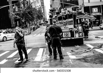 NEW YORK CITY, NEW YORK, USA - CIRCA OCTOBER 2016: Both NYPD and Fire Department officers attending a fire near a busy New York road.