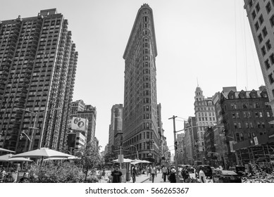 NEW YORK CITY, USA - CIRCA JUNE, 2016: A street view of the Flatiron Building with lots of people passing by on a sunny day. Located midtown Manhattan, New York City.