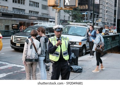 NEW YORK CITY, NEW YORK, USA - CIRCA OCTOBER 2016: NYPD traffic officer seen contemplating near a pedestrian crossing in central NYC, near a subway entrance.