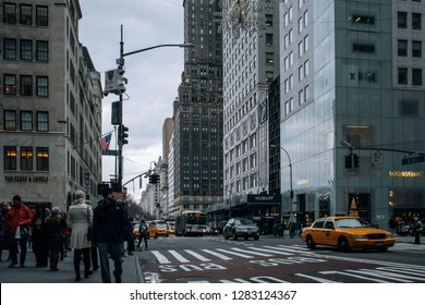 New York City - USA - DEC 17 2018: Old buildings and storefront of fifth avenue street scene in Midtown Manhattan