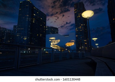 New York City/ USA - December 28th 2019: Pier and Long Island City at sunset, seen from Gantry Plaza State Park, Queens, New York.