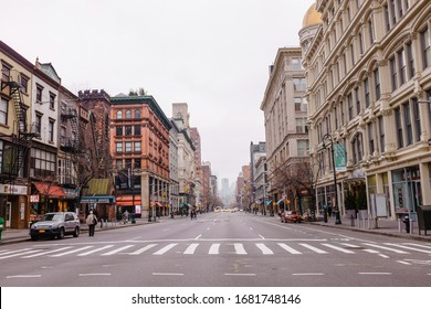 New York City, New York / USA - December 26 2015: Pedestrian crossing with buildings at the side and  few people in New York City on Boxing Day
