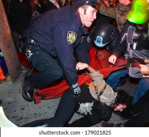 NEW YORK CITY, USA - DECEMBER 17 2011: Occupy Wall Street, protesting financial malfeasance, marked its 90 day anniversary with marches in Manhattan.  NYPD arresting protestors in Midtown Manhattan.