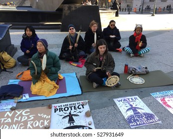 New York City, USA - December 2, 2016. Standing Rock Protesters gather in front of the United States Courthouse in solidarity with Native Americans blocking construction of the Dakota Access Pipeline.
