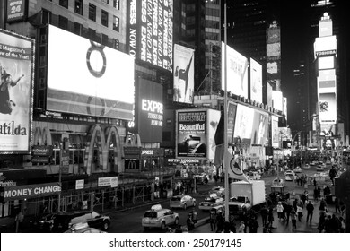 New York City, USA - February 1st, 2015: Times Square is a major commercial intersection and a neighborhood in Midtown Manhattan, New York City.  Black and white photo.