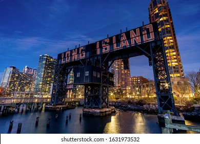 New York City - USA - Jan 21 2020: Night Light Over Long Island City Sign at Gantry Plaza State Park in Queens New York