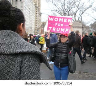 New York City, New York / USA - January 20 2018: A young woman confronts a female Trump supporter at the Women's March in New York City.