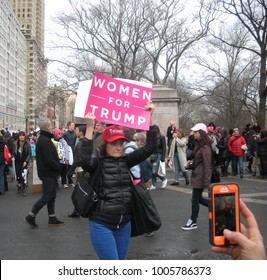 "New York City, New York / USA - January 20 2018: A Trump supporter at that Women's March in New York City holds a pink sign that says, ""Women for Trump""."