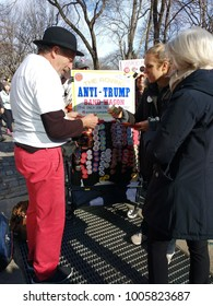 New York City, New York / USA - January 20 2018: A vendor sells anti-Trump buttons at the Women's March.