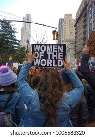 "New York City, New York / USA - January 20 2018: A demonstrator at the New York City Women's March holds a sign that says, ""Women of the World""."