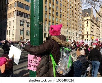 New York City, New York / USA - January 20 2018: A demonstrator wearing a pink pussyhat and see-through backpack looks above the crowd at the New York City Women's March 2018.