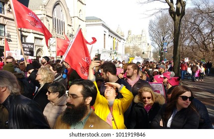 New York City, New York / USA - January 20 2018: Flags of the Democratic Socialists of America (DSA) are carried through the crowd during the New York City Women's March.