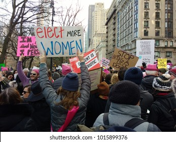 "New York City, New York / USA - January 20 2018: A demonstrator in the Women's March crowd carries a sign that says, ""Elect More Women""."