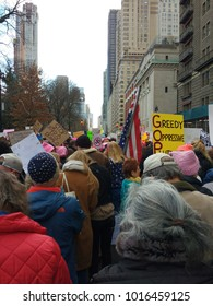 New York City, New York / USA - January 20 2018: The NYC Women's March on Central Park West. Among the marchers, a person with grey hair, highlighting the diversity in ages participating in the event.