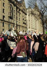 New York City, New York / USA - January 20 2018: Excited crowd on Central Park West during the Women's March on New York City.