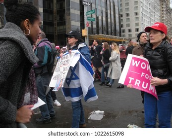 """New York City, New York / USA - January 20 2018: A Trump supporter holds a pink sign that says, """"Women For Trump"""" during the Women's March on New York City."""