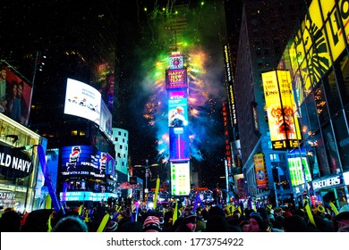 New York City, USA, January 1, 2018, New year's eve celebration on famous times square intersection at midnight with countless happy people enjoying.