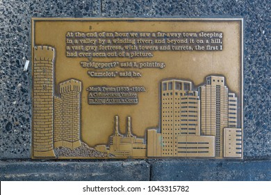 "NEW YORK CITY, USA – JULY 15, 2013: A bronze plaque with a quote by Mark Twain, one of the 96 plaques embedded in the pavement called ""Library walk"" along E 41st street in front of 5th Avenue."