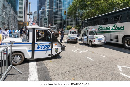 """NEW YORK CITY, USA – JULY 16, 2013: NYPD policemen on 6th Avenue in New York during the preparation of the public event """"MLB All Stars of the Game 2013""""."""