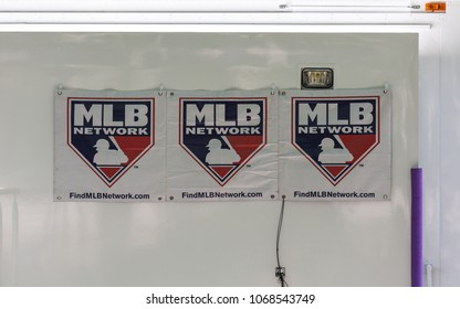NEW YORK CITY, USA – JULY 16, 2013: Posters with Major League Baseball (MLB) logo on the sports journalists ' car near Bryant Park in new York city on MLB all-Star game Red Carpet Show.