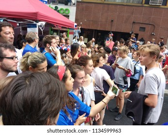 New York City, New York / USA - July 15 2018: During the French InstituteAlliance Français Bastille Day Street Fair, spectators watch the World Cup Final on cell phones when the live stream failed.