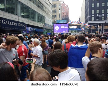 New York City, New York / USA - July 15 2018: During the French Institute Alliance Français Bastille Day Street Fair, spectators watch the World Cup Final on cell phones when the live stream failed.