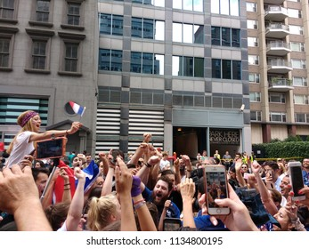 New York City, New York / USA - July 15 2018:Happy fans at the French InstituteAlliance Français Bastille Day Street Fair following France's 2018 World Cup victory.