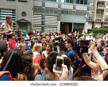 New York City, New York / USA - July 15 2018:A fan gets interviewed by the media at the French InstituteAlliance Français Bastille Day Street Fair following France's 2018 World Cup victory.
