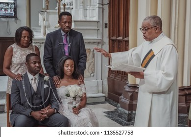 NEW YORK CITY, USA - July 10, 2018: african american just married couple outside the church