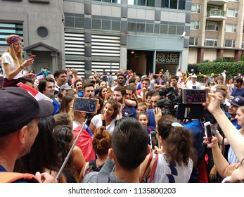 New York City, New York / USA - July 15 2018:A reporter interviews a soccer fan at the annual French InstituteAlliance Français Bastille Day on 60th Street following France's 2018 World Cup victory.