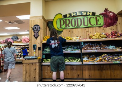 New York City, USA - July 26, 2018: People buying in a Brooklyn supermarket in New York City, USA