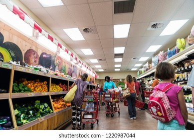 New York City, USA - July 26, 2018: People of different races buying in a Brooklyn supermarket in New York City, USA