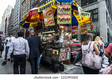 New York City, USA - July 25, 2018: Food truck of hot dog, falafel, kebab, burger in Fifth Avenue with people around in New York City, USA