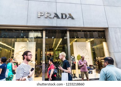 New York City, USA - July 28, 2018: Prada, luxury clothing store, in Fifth Avenue (5th Avenue) with people around in Manhattan in New York City, USA