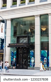 New York City, USA - July 28, 2018: Tommy Hilfiger, luxury clothing store, in Fifth Avenue (5th Avenue) with people around in Manhattan in New York City, USA