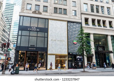 New York City, USA - July 28, 2018: Fifth Avenue (5th Avenue) with luxury shops and people around in Manhattan in New York City, USA