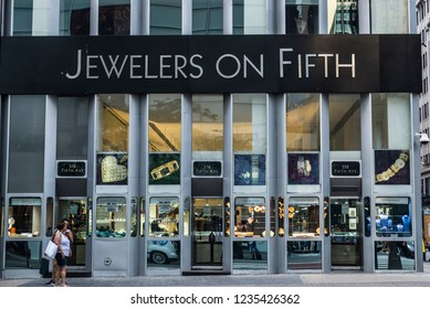 New York City, USA - July 28, 2018: Facade of a luxury Jewelers on Fifth jewelry in Fifth Avenue (5th Avenue) with people around in Manhattan in New York City, USA